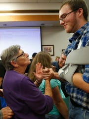 Muriel Luker, a member of the Burnette Chapel Church of Christ in Antioch talks with Caleb Engle after Engle was honnored as a hero during a special ceremony at La Vergne City Hall  Tuesday, Oct. 3, 2017. Engle was honored for for his brave efforts at stopping a gunman at his church on Sunday Sept. 24, 2017.