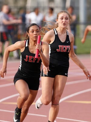 Makayla Brock of Lafayette Jeff receives the baton from teammate Janessa Hickman as she runs the anchor leg for Lafayette Jeff in the girls 4 X 100 meter relay during the City County Track Meet Monday, May 1, 2018, at Lafayette Jeff. Jeff won the event with a new City County Track Meet record of 49.21.