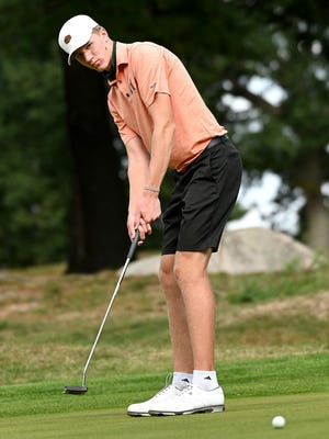 Hopkinton senior Ryan Lundy, one of the captains of the golf team, follows a putt during tryouts Tuesday at Hopkinton Country Club.