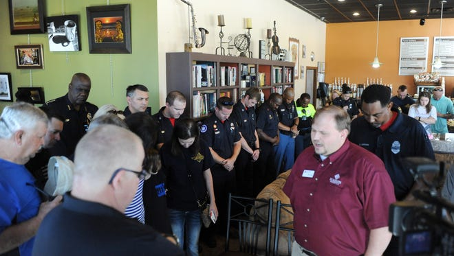 Hattiesburg residents and law enforcement gather during coffee with a cop at Java Werks on Tuesday. A prayer service was also held to honor fallen Hattiesburg officers Benjamin Deen and Liquori Tate.