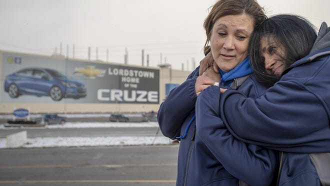Tammy Daggy, of Salem, Ohio, and Marisol Bowers, of Youngstown, Ohio, both employees of General Motors for 24 years, hug as people gather in front of the General Motors assembly plant, Wednesday, March 6, 2019, in Lordstown, Ohio.