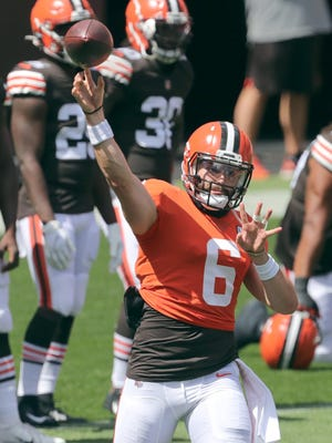 Browns quarterback Baker Mayfield throws a pass during practice Sunday at FirstEnergy Stadium in Cleveland.