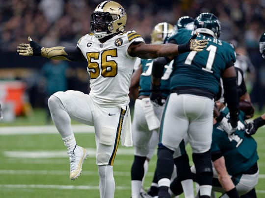FILE - In this  Sunday, Nov. 18, 2018 file photo, New Orleans Saints outside linebacker Demario Davis (56) celebrates a defensive stop in the first half of an NFL football game against the Philadelphia Eagles in New Orleans. Saints linebacker Demario Davis is about to make his playoff debut after what he considers the most productive and professionally satisfying season of his career. Davis' 110 tackles led the Saints. His five sacks tied a career high. (AP Photo/Bill Feig, File)