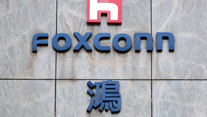 "epa05935746 A view of the logo on the Hon Hai Foxconn plant in Neihu, Taipei, Taiwan, 29 April 2017. Hon Hai and Foxconn Chairman Terry Gou visited the White House on both 27 and 28 April 2017. On 28 April, leaving the Whilte House, Gou told reporters that Foxconn is planning an investment in the US. 'We are planning a number of investments in America. This project will include both capital-intensive, skilled-labour-intensive and high-tech investment. We are not final yet. I think we will share (announce the outcome) with you in the summer, maybe a few weeks,"" he said. Taiwanese and Japanese press speculate that Gou plans to honour his 2013 pomise to build an LED panel plant - worth 7 billion US dollars - in the US, in response to US President Donald Trump's call to keep manufacturing in the US and create jobs in the US. Hon Hai, also known as Foxconn, is the world's largest contract electronics manufacturer and assembler of iPhone. It has factories all over the world including a doze plants hiring one million workers in China. Last year Foxconn bought majority stake in the debt-ridden SHARP CORP of Japan and it is now seeking to buy TOSHIBA's chip unit.  EPA/DAVID CHANG ORG XMIT: TWN11"