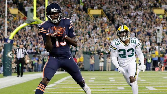 Chicago Bears wide receiver Kendall Wright (13) catches a touchdown pass beyond the coverage of Green Bay Packers cornerback Damarious Randall (23) in the second quarter on Thursday, September 28, 2017 at Lambeau Field in Green Bay, Wis.