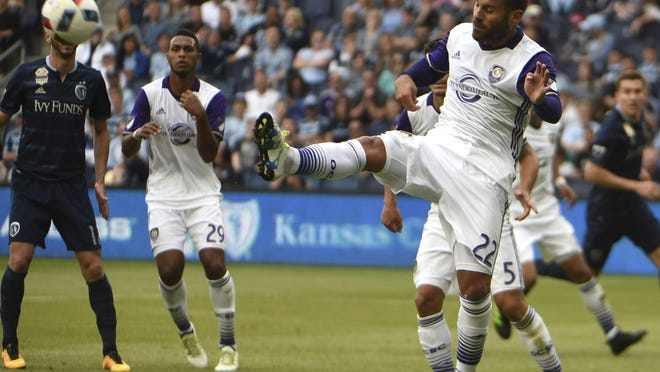 May 15, 2016; Kansas City, KS, USA; Orlando City SC midfielder Antonio Nocerino (22) clears the ball against Sporting KC in the second half at Children's Mercy Park. Kansas City won 2-1. Mandatory Credit: John Rieger-USA TODAY Sports