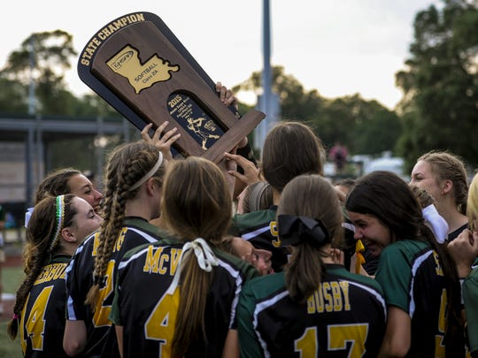 The Menard Lady Eagles raise the Class 2A state championship trophy after defeating Winnfield in the LHSAA Fast Pitch 56 last season.