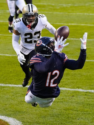 Bears wide receiver Allen Robinson (12) makes a catch for a touchdown in front of Saints cornerback Marshon Lattimore (23) on Sunday in Chicago.