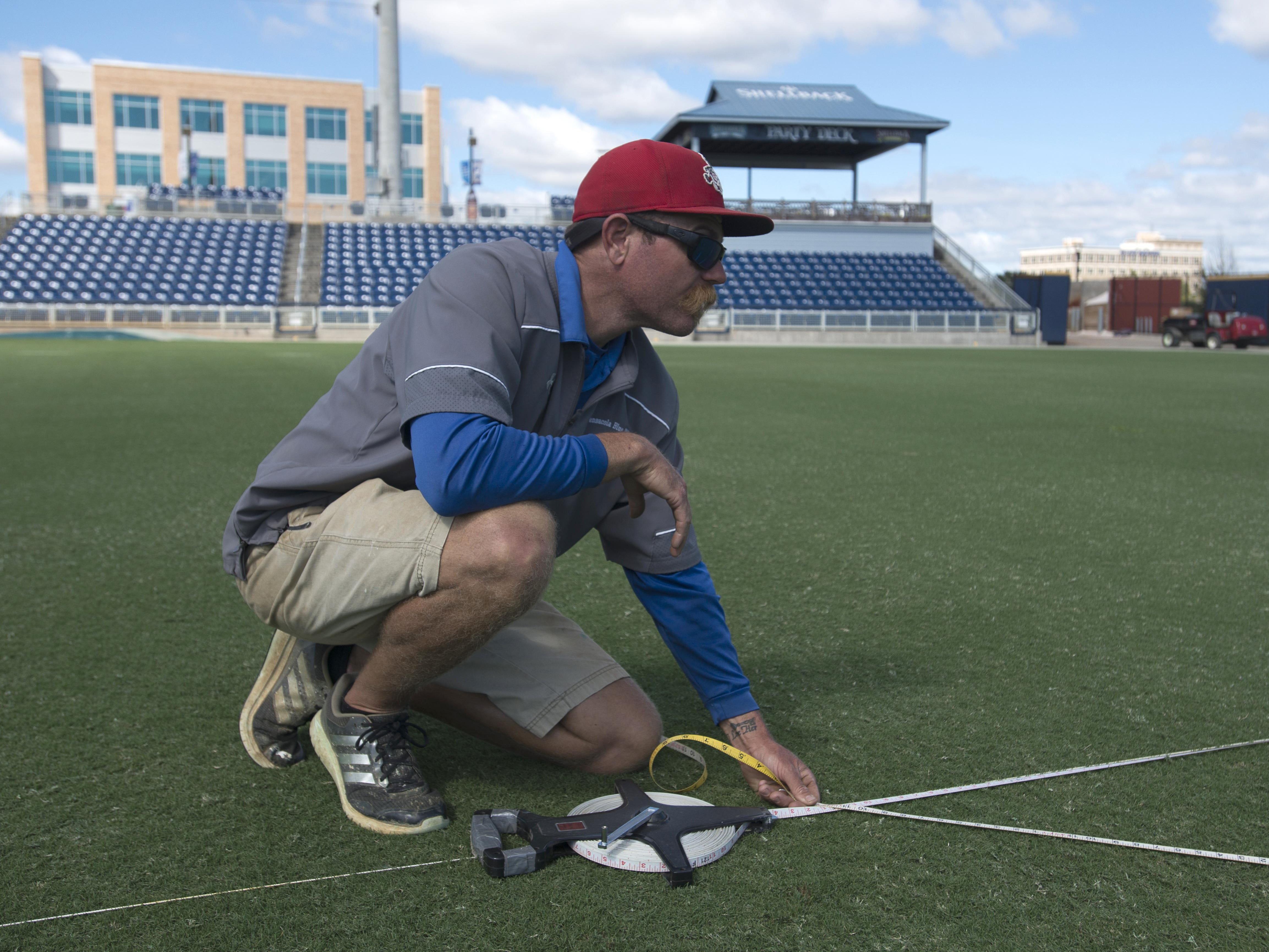 Ray Sayre, director of sports turf management for the Blue Wahoos, stripes Fetterman Field at Blue Wahoos Stadium into a football field for Saturday's Soul Bowl and UWF Football on Oct. 17.