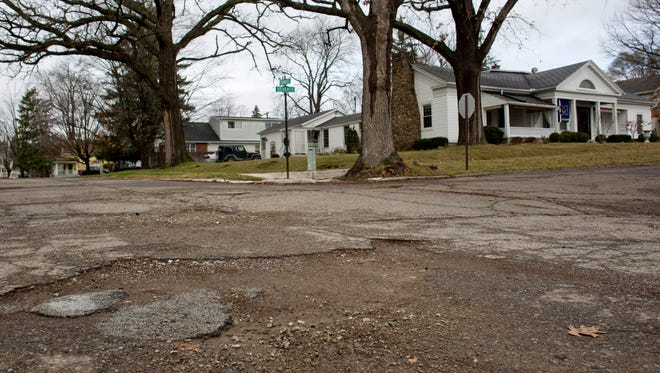 Large potholes are seen along Trumbull Street in St. Clair. Voters will be asked March 8 to renew a 2.49 mill streets tax for another 10 years. The tax would bring in about $470,000 annually.