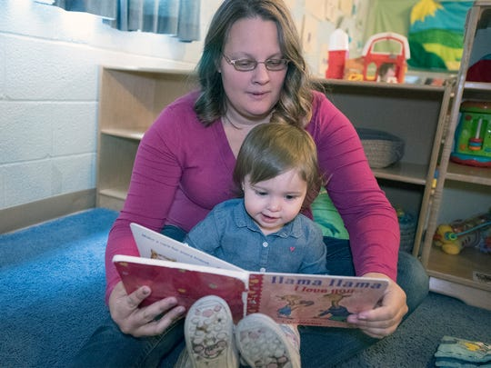 Destini Boxall reads to her daughter, Aislynn, 19-months-old  enrolled in the Frankiln County Head Start program in Waynesboro. Head Start is partnering with Keystone Health to help pregnant mothers improve the education of their children.