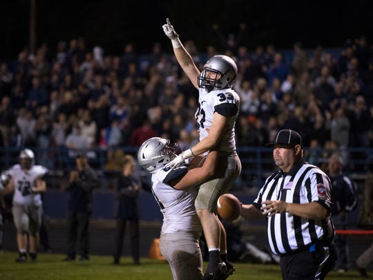 Reitz's Carter Schnarr (33) celebrates a touchdown against Castle at John Lidy Field Friday night.