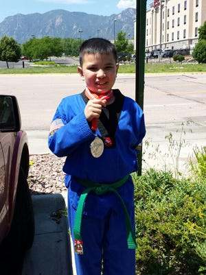 Isaac Lizama, 9, won a silver medal at the Seventh Annual Taekwondo Hanmandang U.S. Open held at the Broadmoor World Arena in Colorado Springs, Colorado. His parents are Florence Stair Caoile, formerly of Asan and a resident of San Diego, California, and Daniel Lizama, formerly of Yona and now a resident of Colorado Springs. Isaac LizamaÕs grandparents are Elaine and Joaquin Lizama of Yona, and Forrest and Ruth Stair of Yona. He attended kindergarten through second grade at CL Taitano Elementary School.Photo courtesy of Florence Stair Caoile