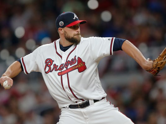 Atlanta Braves relief pitcher Jim Johnson (53) works in the ninth inning of a baseball game against the San Diego Padres, Saturday, April 15, 2017, in Atlanta. Atlanta won 4-2. (AP Photo/John Bazemore)