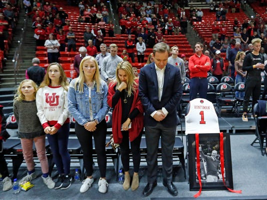 Paul Huntsman, right, and family members stand during a tribute for longtime Utah donor, supporter and billionaire philanthropist Jon M. Huntsman Sr., who died last week, at the start of an NCAA college basketball game between Stanford and Utah on Thursday, Feb. 8, 2018, in Salt Lake City. (AP Photo/Rick Bowmer)