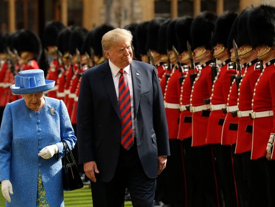 President Trump and Queen Elizabeth II inspect a Guard