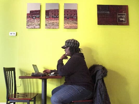 Joan Wright of Philadelphia takes advantage of the Green Bean Roasting Co. s wireless Internet during a recent visit.