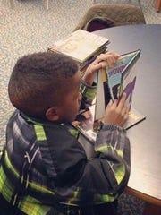 Jarrett Nelson reading a book at school.