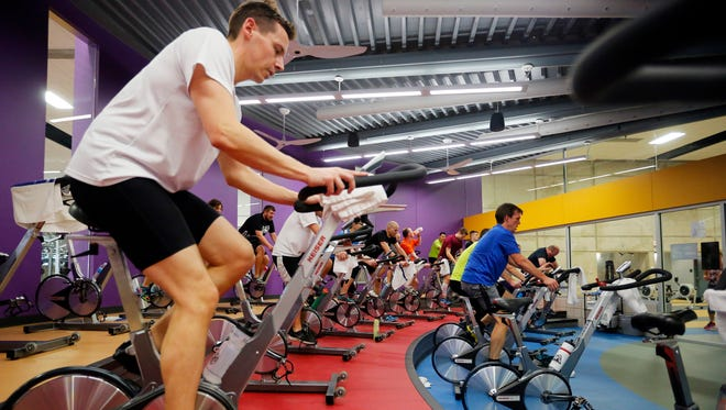 Mitch Kunert rides a spinning bike during a class Feb. 17 at the Wellmark YMCA in downtown Des Moines.