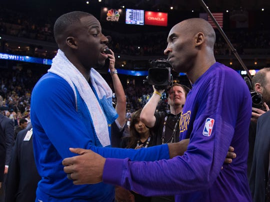 Draymond Green and Kobe Bryant talk after a game at Oracle Arena. The Warriors defeated the Lakers 116-98.