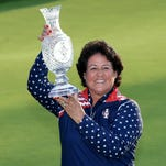 Nancy Lopez, one of the vice-captains of the United States Team, proudly holds the Solheim Cup trophy after the closing ceremony during the final day singles matches in the 2015 Solheim Cup at St Leon-Rot Golf Club on September 20, 2015 in Sankt Leon-Rot, Germany.
