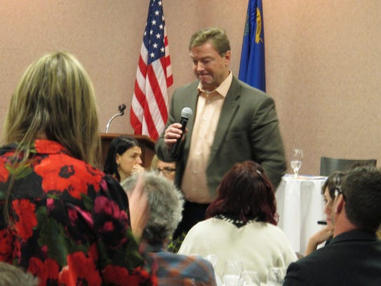 Sen. Dean Heller, R-Nev., listens to a question during