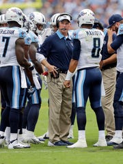 Tennessee Titans head coach Ken Whisenhunt talks with his team during a recent game.