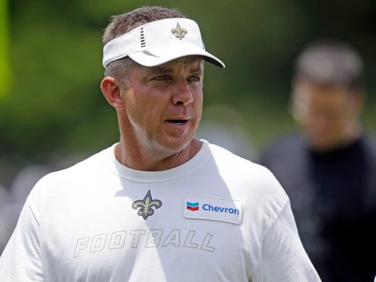 FILE - In this June 12, 2014, file photo, New Orleans Saints head coach Sean Payton walks off the field during NFL football minicamp at the team's training facility in Metairie, La. Payton always searches for an edge, even if it means fiddling with a training camp formula that has worked well. After holding camp for five years at team headquarters in suburban New Orleans, the Saints are headed to the mountains of West Virginia.  (AP Photo/Gerald Herbert, File)