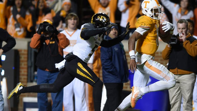 Tennessee quarterback Joshua Dobbs (11) runs for a touchdown with Missouri defensive back John Gibson defending during the second half at Neyland Stadium on Saturday, Nov. 19, 2016.
