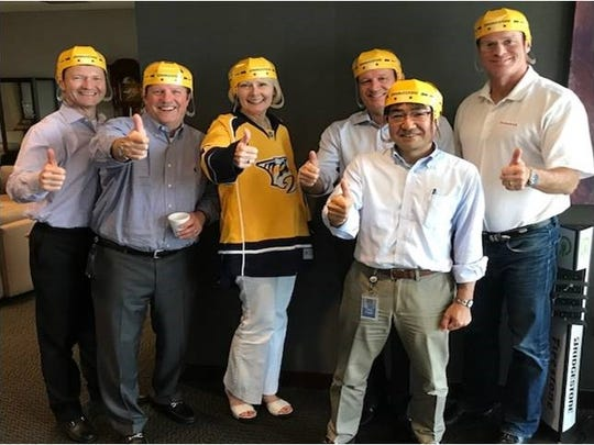 Bridgestone Americas and its leaders are standing with the Preds during this playoff run. From left are TJ Higgins, Philip Dobbs, Christine Karbowiak, Gordon Knapp, Toru Nagase and Bill Thompson.