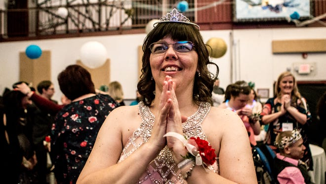 Heather Showman classes her hands together after she, and every other guest at a Night to Sine were crowned prom king and queens. The dance which happens in churches across the world on the same night honors those with special needs by giving them a night they will always remember.