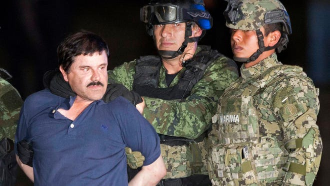"In this Jan. 8 photo, Joaquin ""El Chapo"" Guzman is made to face the news media as he is escorted to a helicopter in handcuffs by Mexican soldiers and marines at a federal hangar in Mexico City after his recapture six months after escaping from a maximum security prison. Guzman's lawyers said Friday that he told them the guards at Mexico's Altiplano prison won't let him sleep and that plans to make a movie about his life with Mexican actress Kate Del Castillo are still on."