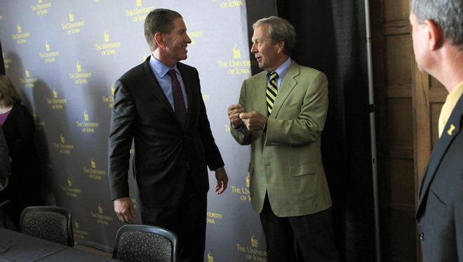 Iowa Board of Regents President Bruce Rastetter, left, chats with newly-appointed University of Iowa President Bruce Harreld at the Iowa Memorial Union on Thursday, Sept. 3, 2015.