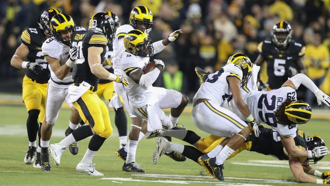 Michigan's Jabril Peppers is tackled by Iowa defenders during the second half of U-M's 14-13 loss Saturday, Nov. 12, 2016 in Iowa City, Iowa.