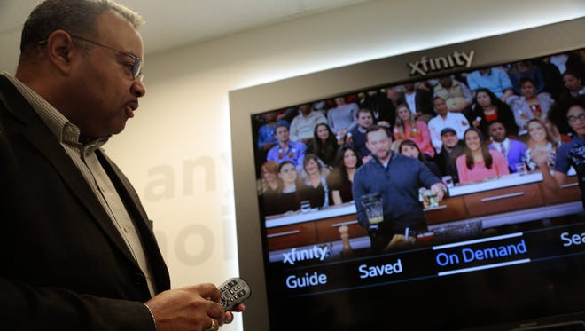 Comcast Director of Public Relations Randy L. Jones demonstrates the voice guidance beta that speaks to the user reading on screen text and show descriptions on the new X1 Platform from XFINITY.