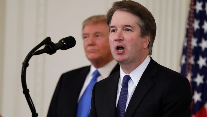President Donald Trump listens as Judge Brett Kavanaugh his Supreme Court nominee speaks, in the East Room of the White House on Monday.