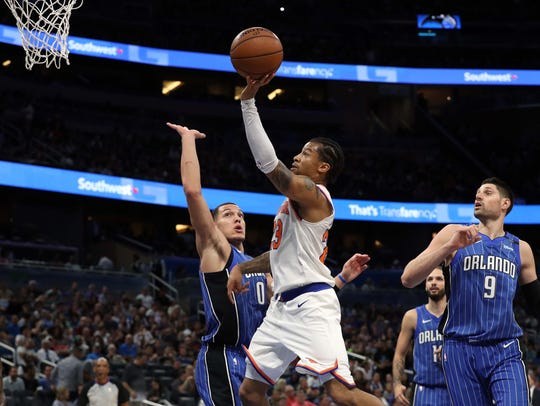 New York Knicks guard Trey Burke (23) shoots over Orlando