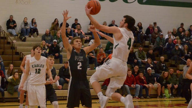 Olivet's Colin Grady goes up for a layup against Perry on Tuesday.
