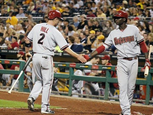 July 3, 2014: Diamondbacks second baseman Aaron Hill (2) is greeted by shortstop Didi Gregorius (R) after Hill scored a run against the Pittsburgh Pirates during the ninth inning at PNC Park. The Diamondbacks won 10-2.