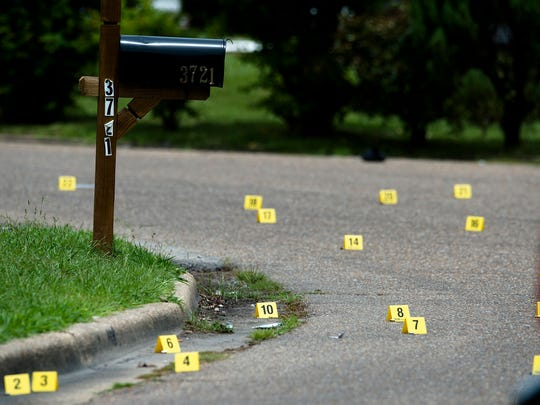 Montgomery Police investigate a shooting on the 3700 block go Cresta Circle in Montgomery, Ala., on Thursday, Aug. 3, 2017. Approximately 29 markers were set down next to bullet shells.