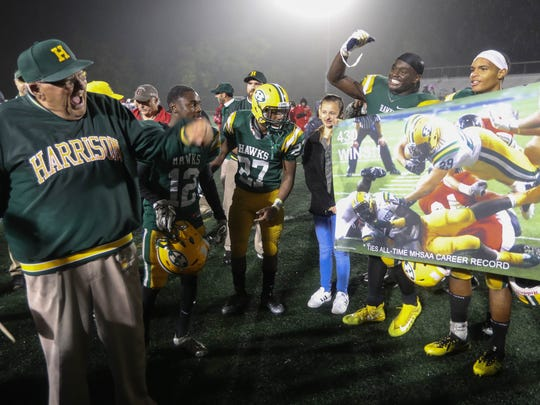 Farmington Hills Harrison coach John Herrington celebrates his 17-14 win against Oak Park to tie the state record for the most wins by a high school coach at Harrison on Friday, Oct. 6, 2017.