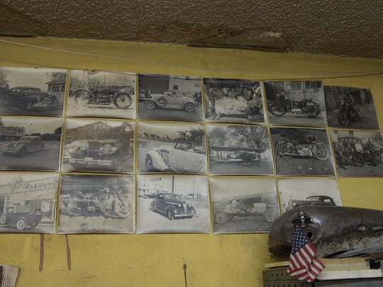 Seventeen photographs of vintage motorcycles and automobiles keep watch over the floor of the Mountain Home Machine Shop.