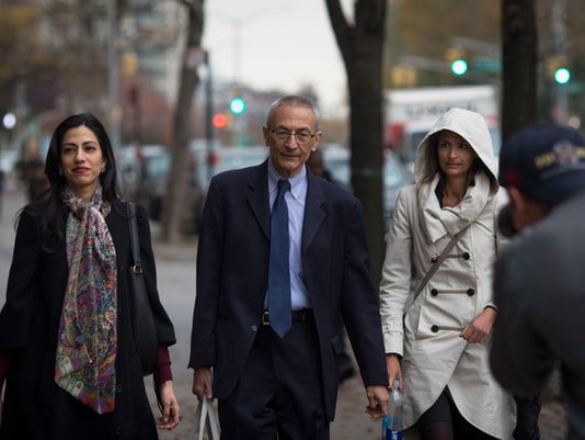 Huma Abedin, left, and John Podesta walk near Hillary ClintonÕs campaign headquarters in Brooklyn on the day after the election.
