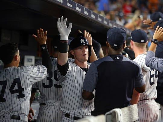 Yankees left fielder Clint Frazier (facing) celebrates