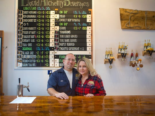 Liquid Alchemy Beverages owners Jeffrey Cheskin, left, and Terri Sorantino pose for a portrait behind the bar at their year-old establishment. The Elsmere-area business will unveil a new collaborative mead Saturday.