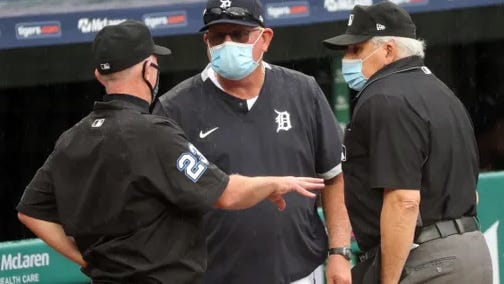 Tigers manager Ron Gardenhire talks to umpires during a rain delay called before the start of action against the Cincinnati Reds at Comerica Park, Saturday, August 1, 2020.
