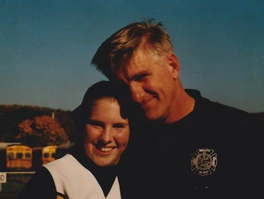 Bob Bronson and his daughter, Nicole Dziedzic, pose