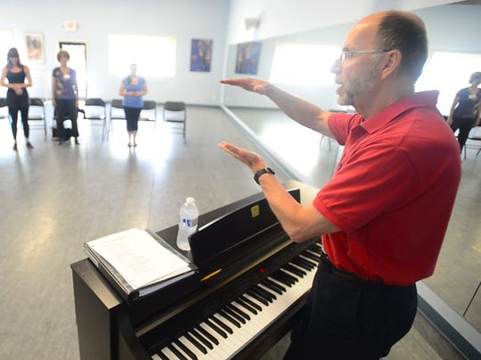 Voice coach Bill Reed works with a group of older students at the 2014 Musical Theater Performance Intensive Workshop at Spotlight on Dance's studio in South Burlington.