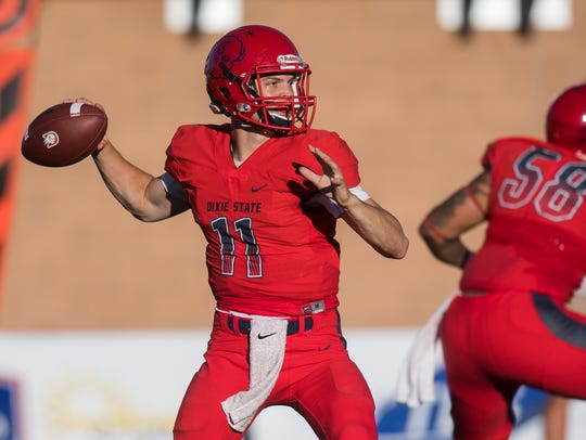 Dixie State's Trent Darms (11) is one of five Trailblazer quarterbacks battling for the starting spot in spring practice.