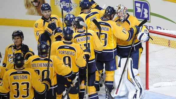 The Predators congratulate goalie Pekka Rinne (35) after their 3-2 win against the Senators in their season opener at Bridgestone Arena Thursday Oct. 9, 2014, in Nashville, Tenn.